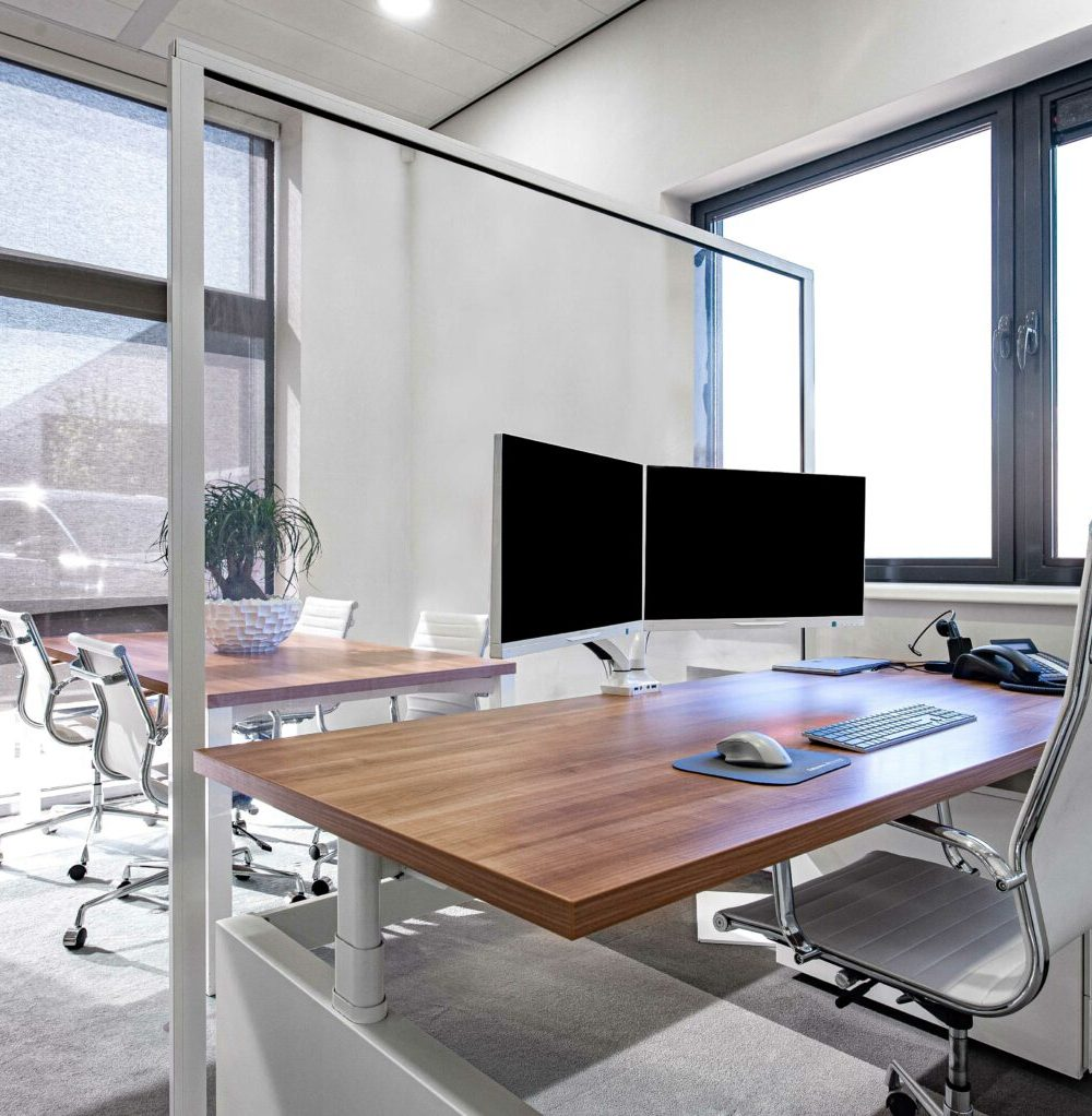 Large Hospitality Shield separating two desks