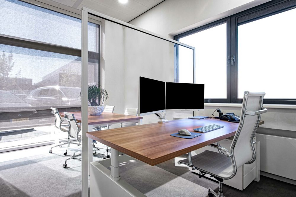 Large Hospitality Shield separating two desks